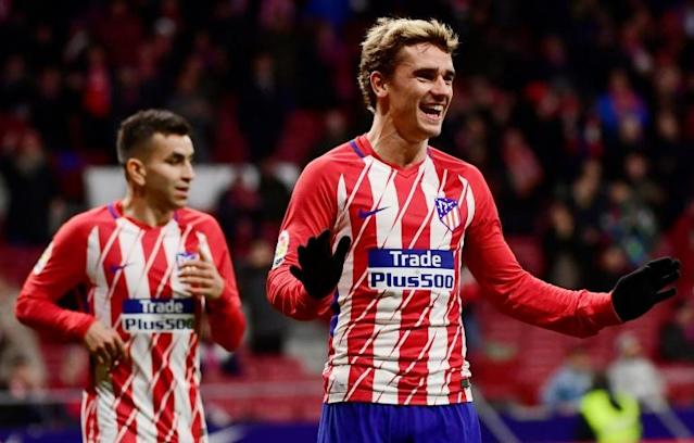 Atletico Madrid's French forward Antoine Griezmann (R) is seen here celebrating during the Spanish league football match Club Atletico de Madrid against Club Deportivo Leganes SAD at the Wanda Metropolitano stadium in Madrid on February 28, 2018