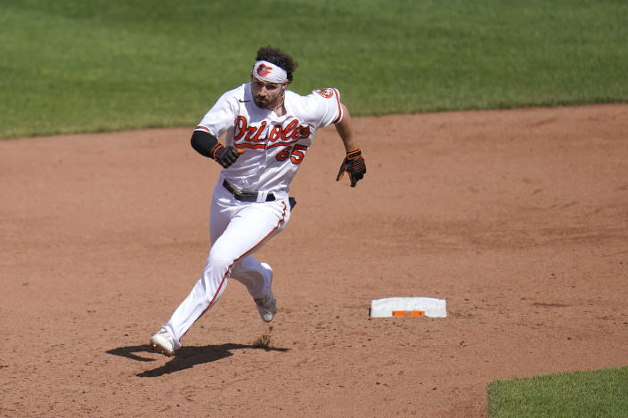 Baltimore Orioles' Ryan McKenna runs past second base while hitting a triple against the Boston Red Sox during the sixth inning of a baseball game, Sunday, April 11, 2021, in Baltimore. (AP Photo/Julio Cortez)