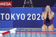 Anastasia Simanovich, of the Russian Olympic Committee, splashes water on her face as she sits on the side of the pool following an 18-5 loss to the United States during a preliminary round women's water polo match at the 2020 Summer Olympics, Friday, July 30, 2021, in Tokyo, Japan. (AP Photo/Mark Humphrey)