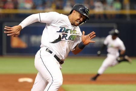 Jun 9, 2018; St. Petersburg, FL, USA; Tampa Bay Rays right fielder Carlos Gomez (27) runs home to score a run during the third inning against the Seattle Mariners at Tropicana Field. Mandatory Credit: Kim Klement-USA TODAY Sports