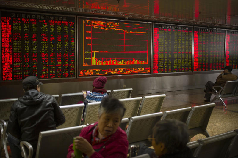 In this Wednesday, Oct. 30, 2019, photo, Chinese investors monitor stock prices at a brokerage house in Beijing. Most Asian stock markets followed Wall Street higher on Thursday, Oct. 31, 2019, after the Federal Reserve cut a key interest rate. (AP Photo/Mark Schiefelbein)