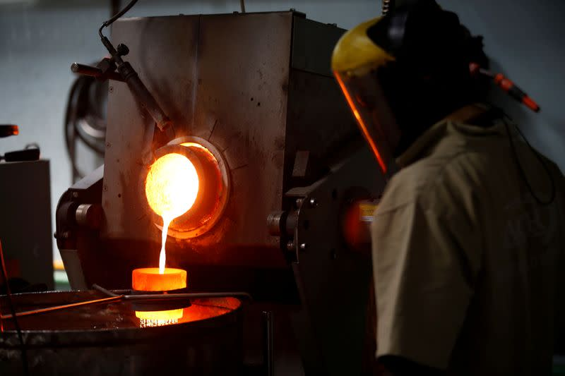 FILE PHOTO: An employee pours liquid gold into a mould for the production of an ingot during the refining process at AGR (African Gold Refinery) in Entebbe