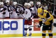 Columbus Blue Jackets' Zach Werenski (8) returns to the bench after scoring during the second period of an NHL hockey game against the Pittsburgh Penguins in Pittsburgh, Saturday, Oct. 5, 2019. (AP Photo/Gene J. Puskar)