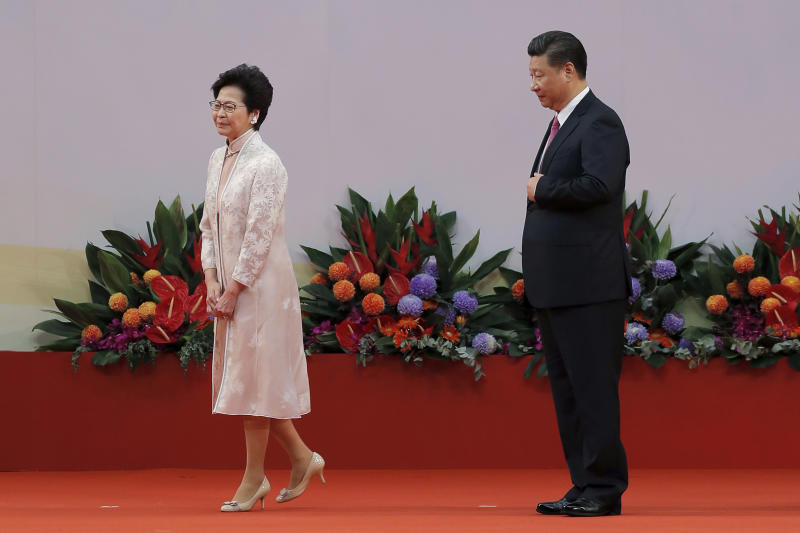FILE - In this Saturday, July 1, 2017, file photo, Chinese President Xi Jinping, right, looks at Hong Kong's new Chief Executive Carrie Lam after administering the oath for a five-year term in office at the Hong Kong Convention and Exhibition Center in Hong Kong. (AP Photo/Kin Cheung, File)