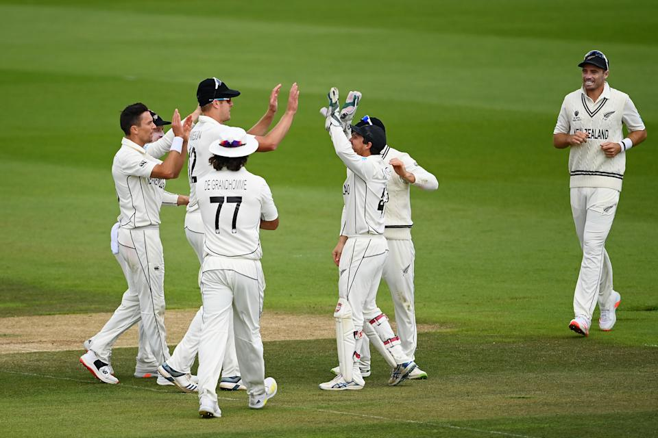 SOUTHAMPTON, ENGLAND - JUNE 23: Trent Boult of New Zealand celebrates the wicket of Ajinkya Rahane of India with teammates during the Reserve Day of the ICC World Test Championship Final between India and New Zealand at The Hampshire Bowl on June 23, 2021 in Southampton, England. (Photo by Alex Davidson/Getty Images)