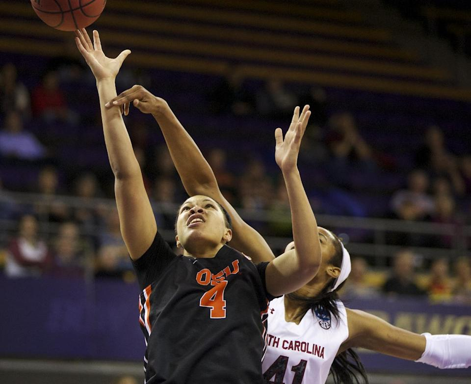 Oregon State's Breanna Brown (4) is fouled by South Carolina's Alaina Coates (41 during the first half of a second-round game of the NCAA women's college basketball tournament, Tuesday, March 25, 2014, in Seattle. (AP Photo/The Oregonian, Randy L Rasmussen)