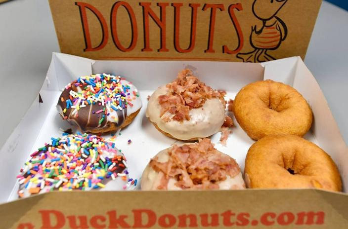Selections at Duck Donuts in State College include Beach Ball, Maple Bacon and plain doughnuts.