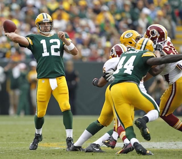 Green Bay Packers' Aaron Rodgers throws during the first half of an NFL football game against the Washington Redskins Sunday, Sept. 15, 2013, in Green Bay, Wis. (AP Photo/Mike Roemer)