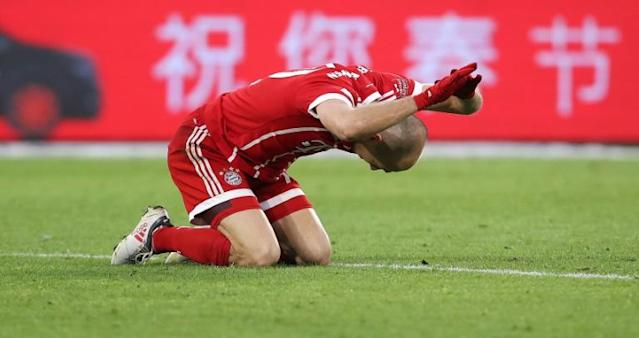 Bayern Munich's midfielder Arjen Robben reacts to a missed penalty