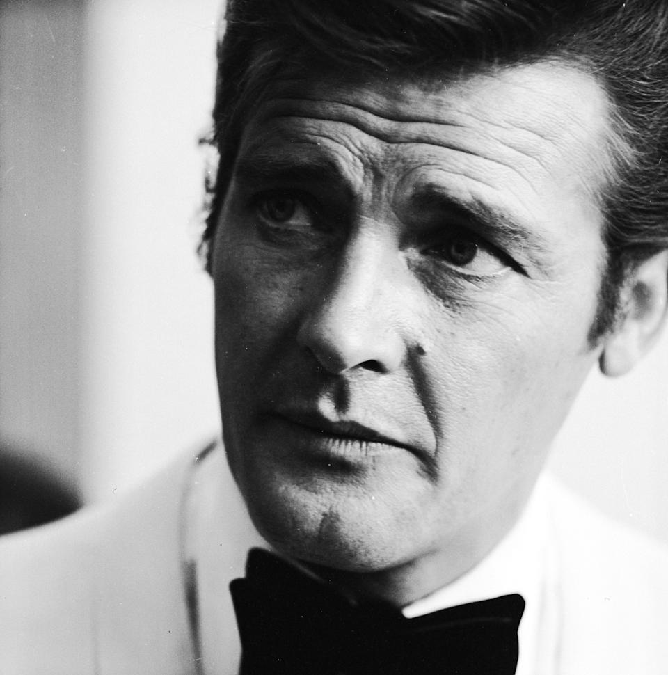"""<p>After a """"short but brave battle with cancer,"""" Moore <a rel=""""nofollow"""" href=""""https://www.yahoo.com/news/roger-moore-died-aged-89-132302559.html"""" data-ylk=""""slk:passed away at 89;outcm:mb_qualified_link;_E:mb_qualified_link;ct:story;"""" class=""""link rapid-noclick-resp yahoo-link"""">passed away at 89</a> on May 23. The English actor is the longest-serving James Bond, having played the suave superspy in seven films. Moore is also remembered for his TV work in <em>The Persuaders! </em>and <em>The Saint</em>. (Photo: Getty Images) </p>"""