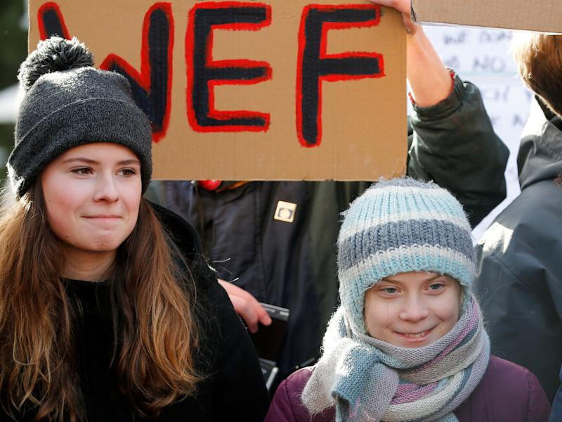 Swedish climate change activist Greta Thunberg and German Luisa Neubauer take part in a climate strike protest during the 50th World Economic Forum (WEF) annual meeting in Davos, Switzerland January 24, 2020. REUTERS/Denis Balibouse