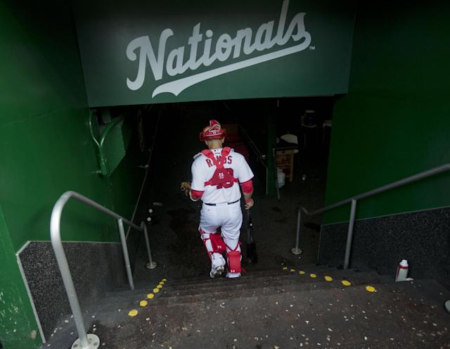 Washington Nationals catcher Wilson Ramos returns to the locker room following the baseball game against the Los Angeles Dodgers, Wednesday, May 7, 2014 in Washington. Ramos returned today from rehab and hit the go-ahead sacrifice fly as the Nationals won 3-2.(AP Photo/Pablo Martinez Monsivais)