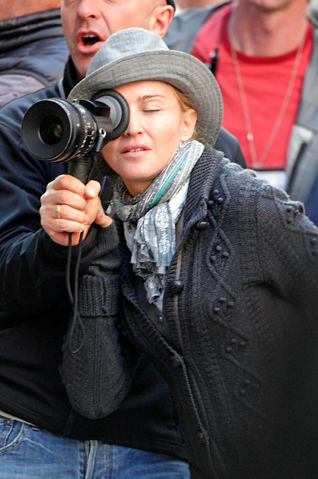 """Back in NYC, Madonna continued her stint behind the lens as director of the upcoming movie """"W.E."""" starring Abbie Cornish. The film, the only one she's helmed other than 2008's """"Filth and Wisdom,"""" is a romantic drama about the relationship between England's King Edward VIII and a divorced American, Wallis Simpson. <a href=""""http://www.splashnewsonline.com"""" target=""""new"""">Splash News</a> - September 13, 2010"""
