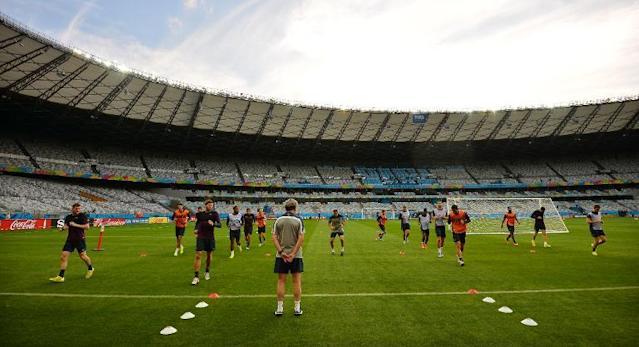 The England football team in a training session at the Mineirao Stadium in Belo Horizonte on June 23, 2014 (AFP Photo/Ben Stansall)