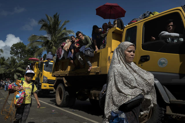 <p>Residents of Marawi who escaped the fighting inside the city, which is being besieged by ISIS-linked militants, endure hours of travel in overloaded vehicles on May 26, 2017, in Marawi City, southern Philippines. (Photo: Jes Aznar/Getty Images) </p>