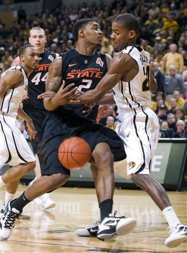Missouri's Kim English, right, knocks the ball away from Oklahoma State's Le'Bryan Nash (2) as Missouri's Matt Pressey, left, and Oklahoma State's Philip Jurick (44) look on during the first half of an NCAA college basketball game Wednesday, Feb. 15, 2012, in Columbia, Mo. (AP Photo/L.G. Patterson)