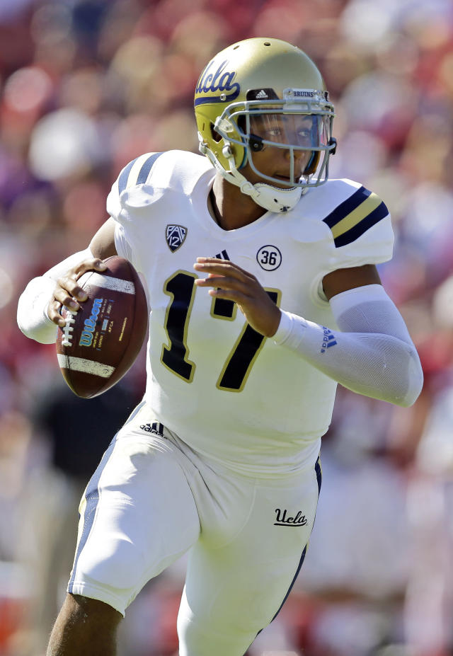 UCLA quarterback Brett Hundley (17) during runs out of the pocket in the first half of an NCAA college football game against Stanford on Saturday, Oct. 19, 2013, in Stanford, Calif. (AP Photo/Marcio Jose Sanchez)