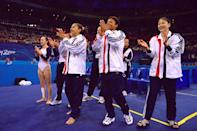 <b>2000 Sydney Olympics</b><br>19 Sep 2000: Tasha Schwikert-Warren (left), Dominique Dawes (centre) and Amy Chow (right) of the USA celebrate their fourth place in the Womens Team Gymnastics Final on Day Four of the Sydney 2000 Olympic Games in Sydney, Australia. Mandatory Credit:Billy Stickland/ALLSPORT