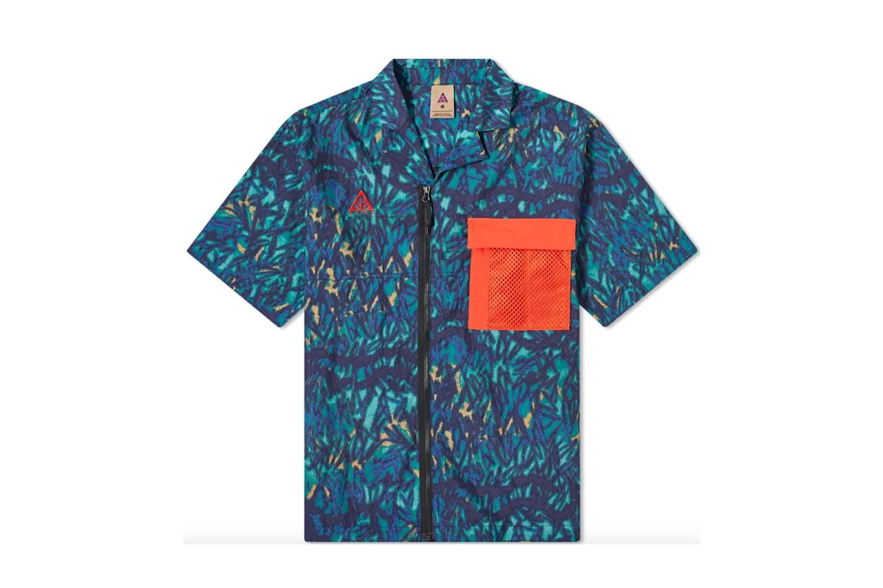 """$125, End Clothing. <a href=""""https://www.endclothing.com/us/nike-acg-all-over-print-shirt-cd7636-405.html"""">Get it now!</a>"""