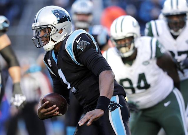Carolina Panthers quarterback Cam Newton (1) scrambles for a short gain as New York Jets' Damon Harrison (94) pursues during the first half of an NFL football game in Charlotte, N.C., Sunday, Dec. 15, 2013. (AP Photo/Chuck Burton)