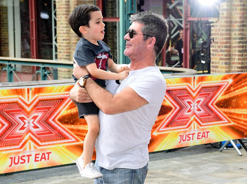 Simon Cowell wants his five-year-old son, Eric, to leave school at 10 [Photo: PA]