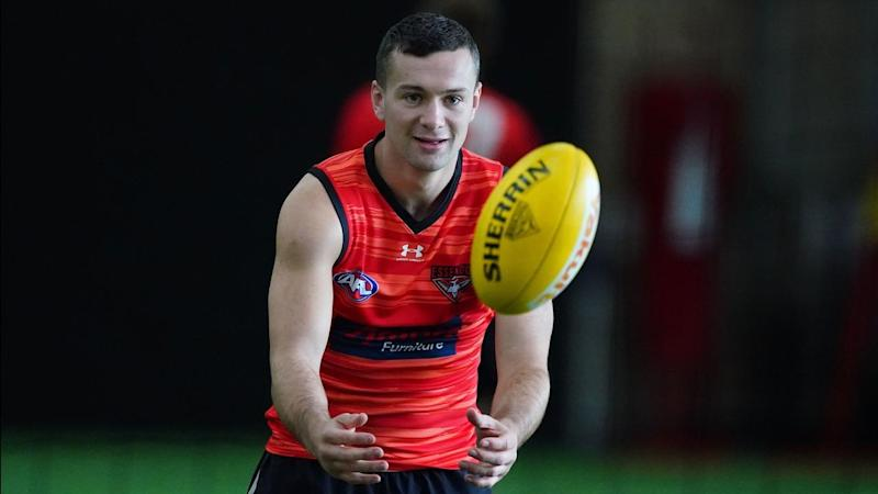 Essendon coach John Worsfold says he's unsure if Conor McKenna (pic) has COVID-19 or not