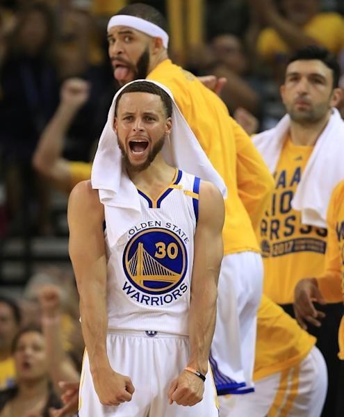 Stephen Curry of the Golden State Warriors celebrates after a basket by a teammate against the Utah Jazz in Game One of the NBA Western Conference semi-finals, at ORACLE Arena in Oakland, California, on May 2, 2017