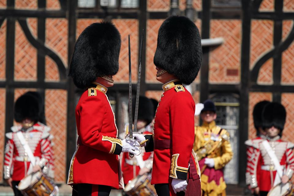 The commanding officers of the old (left) and new guard of the 1st Battalion Grenadier Guards during the Changing of the Guard ceremony (Andrew Matthews/PA) (PA Wire)