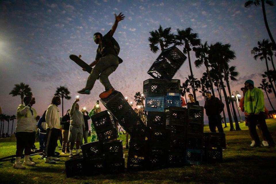 File image: A man falls down of a pyramid of milk crates while he participates if the Milk Crate Challenge (Getty Images)