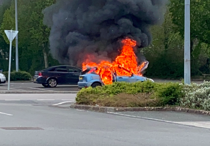 Local shoppers were shocked to see the car burst into flames at the Tesco car park in Plymouth, Devon. (SWNS)