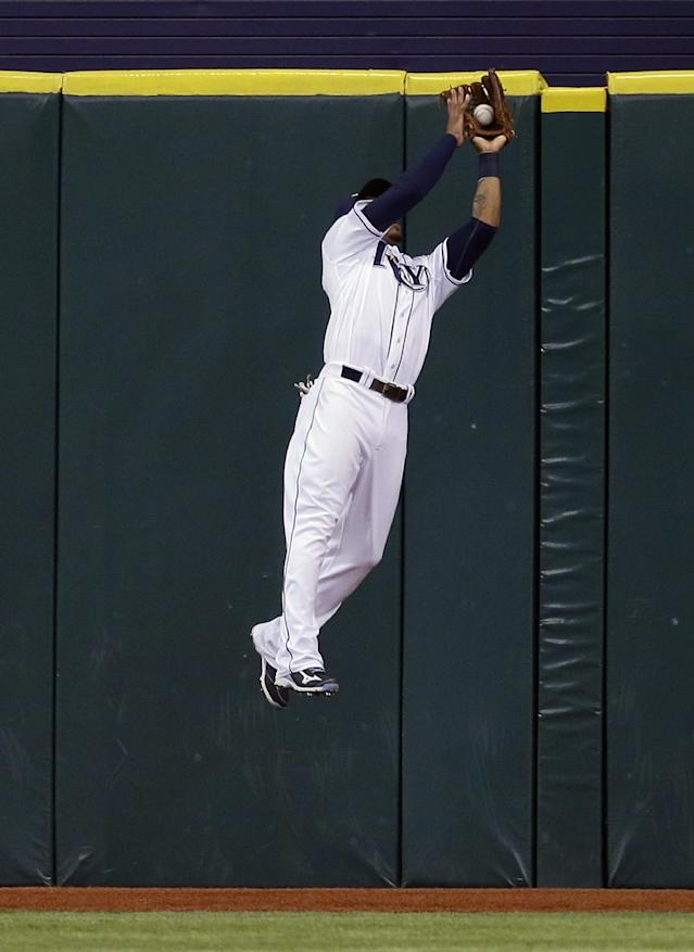 Tampa Bay Rays center fielder Desmond Jennings leaps in the air to make the catch on an RBI sacrifice fly by Boston Red Sox's Jarrod Saltalamacchia during the fifth inning of a baseball game Tuesday, Sept. 10, 2013, in St. Petersburg, Fla. Boston's Jonny Gomes scored on the play. (AP Photo/Chris O'Meara)