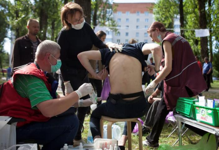 A man receives medical treatment after he was released from a detention centre in Minsk