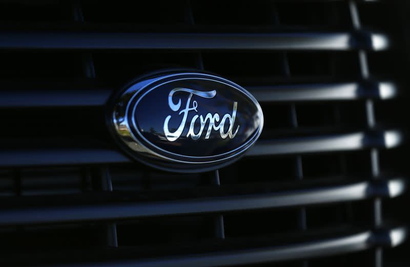 The front grill logo of a Ford F150 pick-up truck is shown in Carlsbad, California
