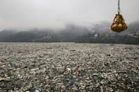 Clearing up the clumps of garbage has become a regular activity for dam operators