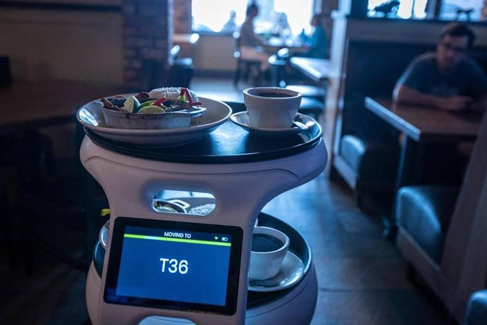 ASTRO, a robot server at Sergio's restaurant in Kendall, heads to table T36 loaded with the order.