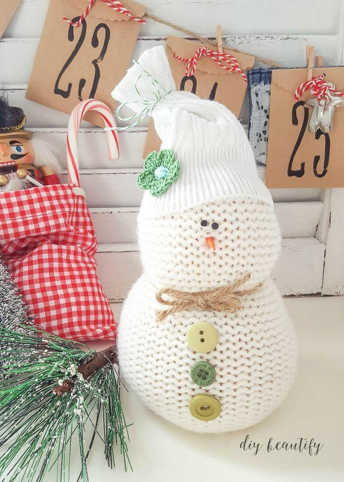 "<p>Put your old, worn sweaters to good use this year and craft an extra cozy creature.</p><p><strong>Get the tutorial at <a href=""https://www.diybeautify.com/2015/12/how-to-make-sweater-snowmen-diy-Christmas-craft.html"" rel=""nofollow noopener"" target=""_blank"" data-ylk=""slk:DIY Beautify"" class=""link rapid-noclick-resp"">DIY Beautify</a>.</strong><br></p><p><strong><a class=""link rapid-noclick-resp"" href=""https://www.amazon.com/Assorted-Childrens-Painting-Handmade-Ornament/dp/B076FLR6X1?tag=syn-yahoo-20&ascsubtag=%5Bartid%7C10050.g.22825300%5Bsrc%7Cyahoo-us"" rel=""nofollow noopener"" target=""_blank"" data-ylk=""slk:SHOP BUTTONS"">SHOP BUTTONS</a><br></strong></p>"