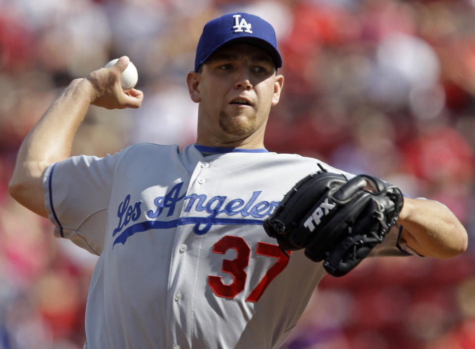 FILE - In this Aug. 29, 2009, file photo, Los Angeles Dodgers pitcher Charlie Haeger throws to a Cincinnati Reds batter during a baseball game in Cincinnati. Police have probable cause to arrest 37-year-old Charles Haeger, a former baseball player, on suspicion of murder and aggravated assault in a fatal shooting Friday, Oct. 2, 2020, in a Phoenix suburn, said Sgt. Ben Hoster, a  Scottsdale Police Department spokesman. The victim's identity was not released. (AP Photo/Al Behrman, File)