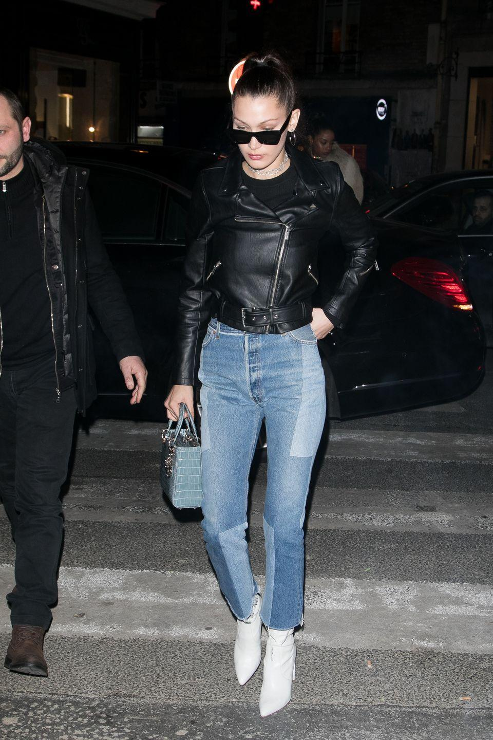 <p>Bella wore denim jeans and a leather jacket to brace the cold, January 2017</p>