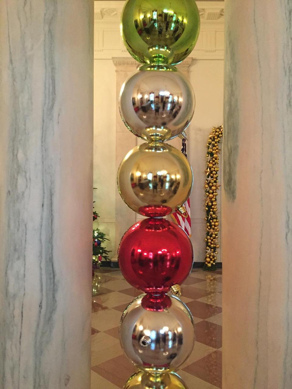 <p>Massive ornament balls were stacked in between the massive marble columns of the grand foyer. <i>(Photo: Cassie Carothers)</i></p>