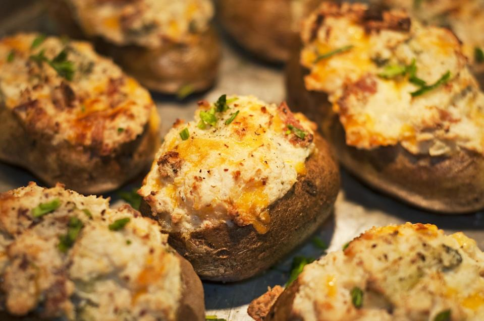 "<p>Twice-baked potatoes are loaded with creamy mashed potatoes, sour cream, cheese and any topping you like. They're ideal for an easy homemade meal, served alongside some vegetables and soup. The addition of crispy, crumbled bacon takes these perfect twice-baked potatoes to the next level.</p> <p><a href=""https://www.thedailymeal.com/recipes/perfect-twice-baked-potatoes-recipe?referrer=yahoo&category=beauty_food&include_utm=1&utm_medium=referral&utm_source=yahoo&utm_campaign=feed"" rel=""nofollow noopener"" target=""_blank"" data-ylk=""slk:For the Twice-Baked Potatoes recipe, click here."" class=""link rapid-noclick-resp"">For the Twice-Baked Potatoes recipe, click here.</a></p>"