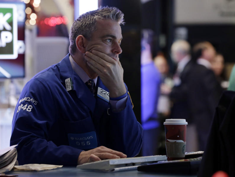 Specialist Christopher Culhane works at his post on the floor of the New York Stock Exchange Friday, Dec. 21, 2012. Stocks opened sharply lower Friday on Wall Street after Republicans in the U.S. House of Representatives called off a vote on tax rates and left federal budget talks in disarray 10 days before sweeping tax increases and government spending cuts take effect. (AP Photo/Richard Drew)