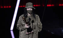 """Billie Eilish accepts the award for top Billboard 200 album for """"When We All Fall Asleep, Where Do We Go?"""" at the Billboard Music Awards on Wednesday, Oct. 14, 2020, at the Dolby Theatre in Los Angeles. (AP Photo/Chris Pizzello)"""