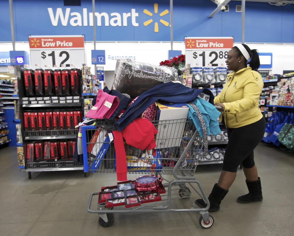 Tasha heads to checkout at a Walmart Store in Chicago, November 23, 2012. Black Friday, the day following the Thanksgiving Day holiday, has traditionally been the busiest shopping day in the United States. (REUTERS/John Gress)