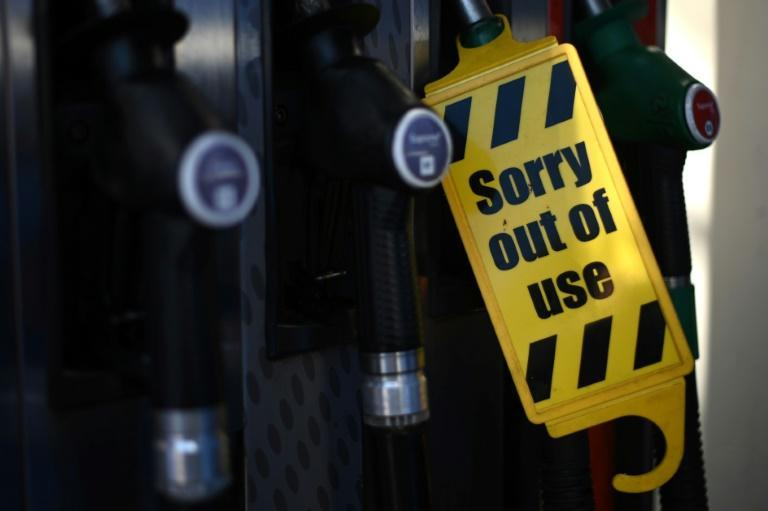 Petrol stations ran dry of certain fuels because of a lack of lorry drivers (AFP/DANIEL LEAL-OLIVAS)