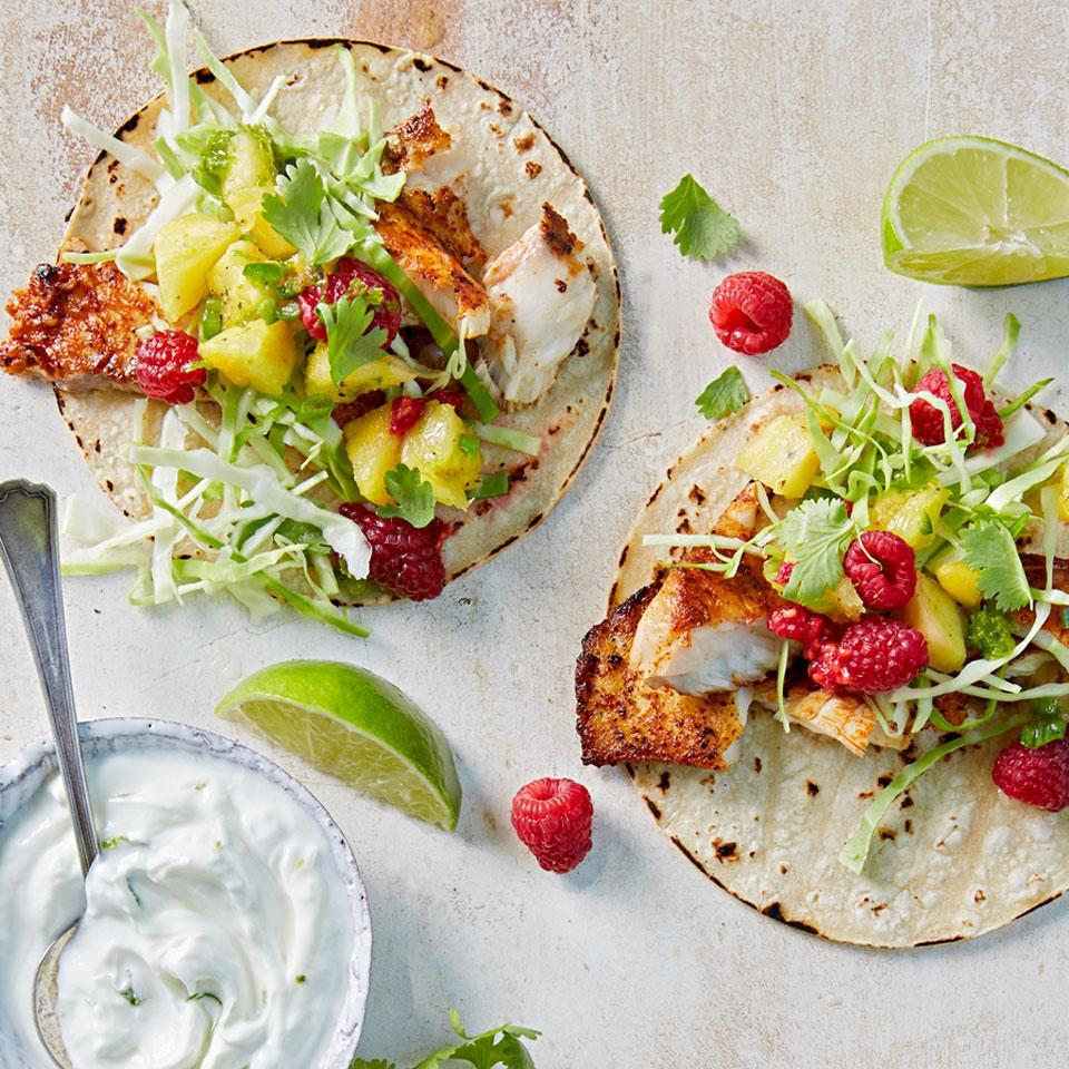 <p>This refreshing version of traditional fish tacos features a lively raspberry-pineapple salsa and a yogurt-lime cream sauce.</p>