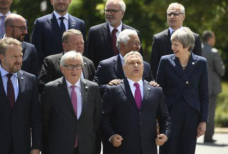 British Prime Minister Theresa May, European Commission President Jean-Claude Juncker and Hungarian Prime Minister Viktor Orban pose among other heads of state during the family photo at the EU-Western Balkans Summit in Sofia, Bulgaria, May 17, 2018. Vassil Donev/Pool via Reuters