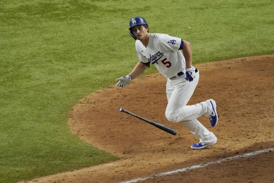 Los Angeles Dodgers' Corey Seager watches his home run against the Tampa Bay Rays during the eighth inning in Game 2 of the baseball World Series Wednesday, Oct. 21, 2020, in Arlington, Texas. (AP Photo/Sue Ogrocki)