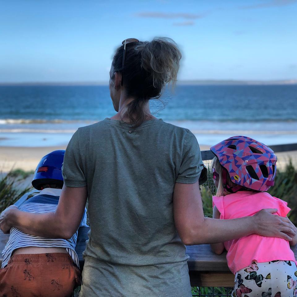 Katherine Chatfield with her two children looking out to sea