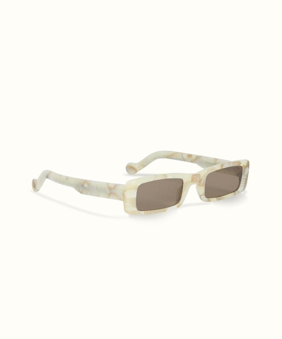 <p><span>Fenty Trouble Sunglasses in White Marble</span> ($250)</p>