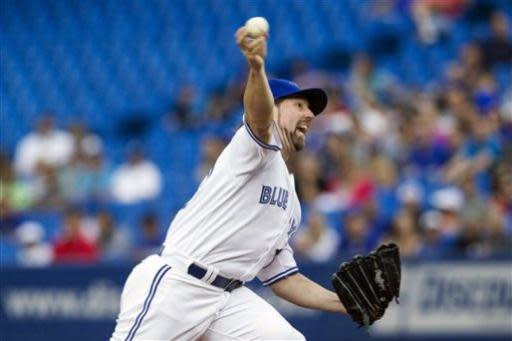 Toronto Blue Jays starting pitcher R.A. Dickey works against Baltimore Orioles during the first inning of a baseball game in Toronto on Friday, June 21, 2013. (AP Photo/The Canadian Press, Chris Young)
